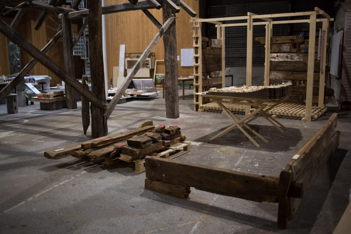 four elements placed at mini exhibition at BAS. (pile of wood from old log house, a corner from old log house, 1:500 model of Sandviken, 1:1 model showing one design structural logic.